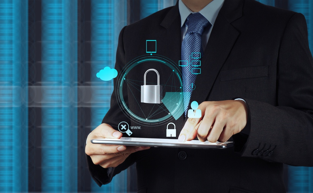 businessman hand pointing to padlock on touch screen computer as Internet security online business concept.jpeg
